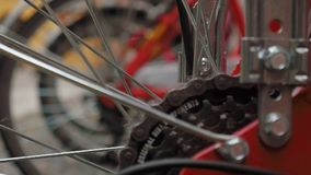 Bikes in a rack, focus shift on bike gears.  stock video