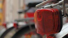 Bikes in a rack, focus shift on bike lights.  stock video