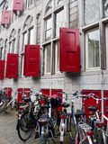Bikes and red shutters Stock Image