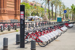 Bikes for rent on bicycle parking in Barcelona Stock Photography