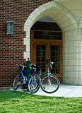 Bikes at school door. Royalty Free Stock Photography