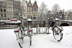 Bikes in the snow in Amsterdam Netherlands Stock Photos