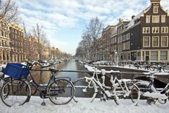 Bikes in the snow in Amsterdam Netherlands. In wintertime Stock Photo