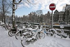 Bikes in the snow in Amsterdam Netherlands Stock Photo