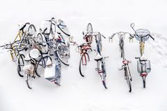Bikes in the snow - bicycles background white winter above view Royalty Free Stock Photos