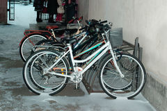 Bikes in the snow on campus. Royalty Free Stock Images