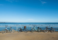 Bikes are standing by the ocean boardwalk in Santa Cruz Stock Photos