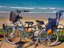 Bikes stands near the sea Royalty Free Stock Photo