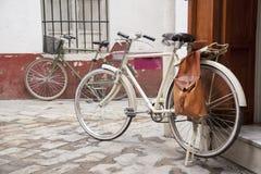 Bikes in Street in the Santa Cruz Neighbourhood of Seville Royalty Free Stock Photo