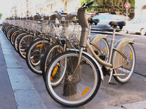 Bikes to rent. Bicycles to rent in a Paris street Stock Photography