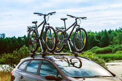 Bikes on top of a car. Royalty Free Stock Photo