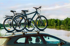 Bikes on top of a car. Royalty Free Stock Images
