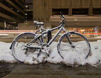 Bikes in Toronto at night with snow on them Royalty Free Stock Photo