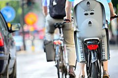Bikes in traffic Stock Photography