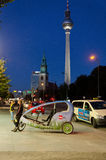 Biketaxi. BERLIN, GERMANY - SEPTEMBER 28: A traditional taxi and rickshaw wait for customers near Alexanderplatz on September 28, 2013 in Berlin, Germany Stock Images