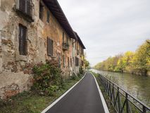 Bikeway along the Naviglio Grande at Robecco: old houses Stock Photo