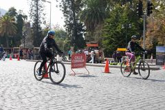 Bikeway in Santiago,Chile. Santiago,Chile - March 27,2016:People riding their bikes on a street that is closed on sunday for the passagem of cars. sign written Stock Photography