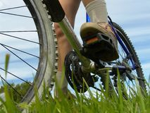 Biking. Feet and bike Stock Images