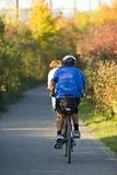 Biking. Cyclist on forest path Stock Photo