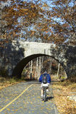 Biking Acadia National Park. Man biking the carriage trails of Acadia National Park Royalty Free Stock Photo