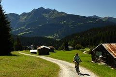 Biking in Alp Nagens, Flims, Graubunden, Switzerland stock image