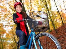 Biking in autumn forest Stock Photo