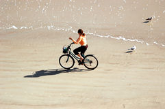 Biking on beach Stock Images