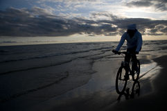 Biking on the beach Royalty Free Stock Photos