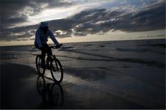 Biking on the beach Royalty Free Stock Image