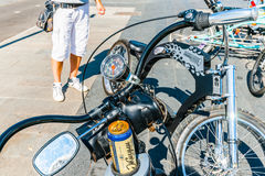 Biking without beer is a waste of efforts. Choppers meeting in Museon park of arts of Moscow, Russia, Friday, July 25, 2014. Expensive bicycles in the style of Stock Images