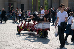 Biking in Berlin together with friends on a unusual bicycle. Royalty Free Stock Photography
