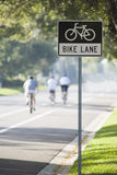 Biking in  bike lane Stock Photo