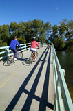 Biking on Bridge. Several people biking on bridge Stock Images