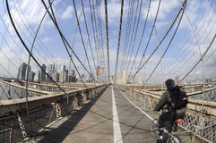 Biking on the Brooklyn Bridge Stock Photography