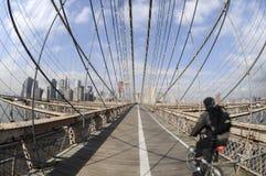 Biking on the Brooklyn Bridge Stock Photography