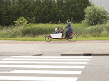 Biking the children to school in the Netherlands Royalty Free Stock Images