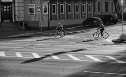Biking in the city. People go on a bike in the city Stock Photo