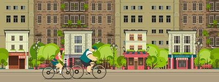 Biking through the city streets Royalty Free Stock Image