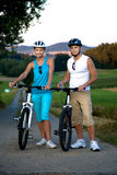 Biking couple Royalty Free Stock Images