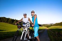 Biking couple Stock Photos