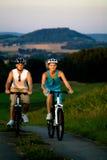Biking couple Royalty Free Stock Image