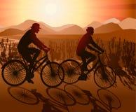 Biking Couple. Enjoying colorful Sunset Royalty Free Stock Image