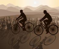 Biking Couple. The Biking Couple against Sunset Stock Photo