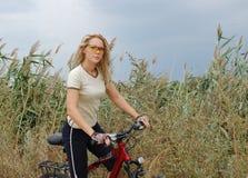 Biking da menina Foto de Stock Royalty Free