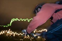 Biking di notte Fotografie Stock