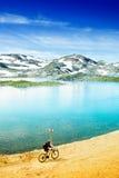 Biking eco tourism. Eco tourism photo, biking in mountains royalty free stock images