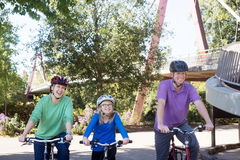 Biking in Eugene. A young family ride along the bike path at Alton Baker Park by the DeFazio bike bridge in Eugene Oregon stock image