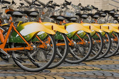 Biking - Green Transport. A row of public bicycles. These bikes are part of the public transport system in Taipei, Taiwan. They help make Taipei a greener city royalty free stock images
