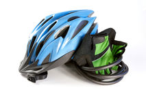 A biking helmet with gloves on a white background Stock Photography