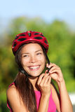 Biking helmet - woman putting bicycle helmet Stock Photo